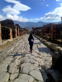 Strolling down cobblestone paths used both by the living and the dead. March 2014. - Pompeii, Italy