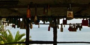Unlike locks on bridges, these lovers sleep open and hidden. April 2015. - Monterosso Al Mare, Italy